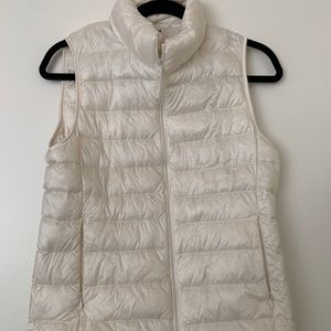 This is a white/creme vest